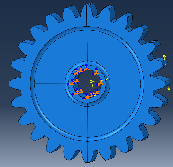the gear is fully constrained in the centre, while a force is applied to separate both teeth and open the crack